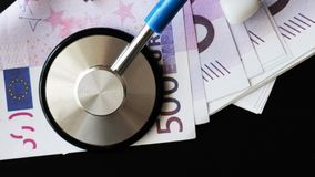 Medical stethoscope on euro bills. Extra close up Royalty Free Stock Photography