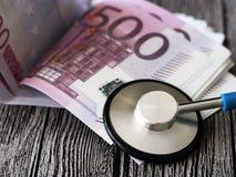 Medical stethoscope on euro bills. Extra close up Royalty Free Stock Photos