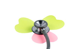 Medical stethoscope flower or phonendoscope isolated on white. Stock Photo