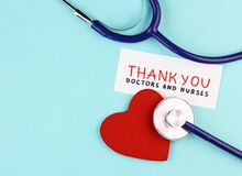 Medical stethoscope, healthy red heart and the inscription Thank you to doctors and nurses on a blue background