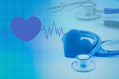 Medical stethoscope and heart. On blue tone royalty free stock photography