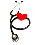 Medical stethoscope and heart isolated on white Stock Image