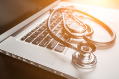 Medical Stethoscope on Laptop Computer Keyboard. Royalty Free Stock Photo