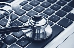 Stethoscope over a laptop keyboard - cybercrime concept image royalty free stock photography