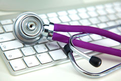 Medical stethoscope lies on a computer keyboard Royalty Free Stock Photo