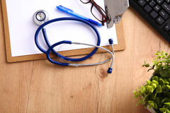 A medical stethoscope lies on the patient`s medical history on a computer background. The concept of medical care or Royalty Free Stock Photos