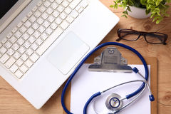 A medical stethoscope lies on the patient`s medical history on a computer background. The concept of medical care or Royalty Free Stock Photo
