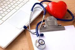 A medical stethoscope lies on the patient`s medical history on a computer background. The concept of medical care or Stock Photos
