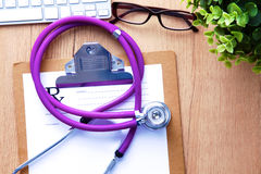 A medical stethoscope lies on the patient`s medical history on a computer background. The concept of medical care or Royalty Free Stock Images