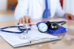 Medical stethoscope lying on cardiogram chart closeup Royalty Free Stock Image