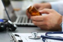Medical stethoscope lying on clipboard pad closeup Stock Photos