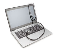 Medical stethoscope on a modern laptop. Royalty Free Stock Photo