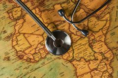 Medical stethoscope over africa healthcheck. close-up map. Medical stethoscope over Africa healthcheck. Fever vaccination concept tourism travel care diseases stock photo