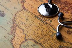 Medical stethoscope over North America healthcheck. close-up. Medical stethoscope over North America healthcheck. Medical concept tourism travel care diseases royalty free stock photo