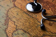 Medical stethoscope over North America healthcheck. close-up. Medical stethoscope over North America healthcheck. Medical concept tourism travel care diseases royalty free stock images