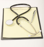 Medical Stethoscope with Pen on Royalty Free Stock Images