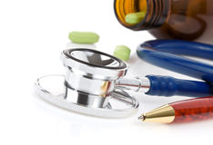 Medical stethoscope with pills Royalty Free Stock Photos