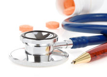 Medical stethoscope with pills Royalty Free Stock Image