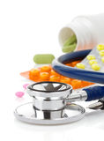 Medical stethoscope with pills Stock Photo