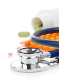 Medical stethoscope with pills Royalty Free Stock Photography