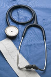 Medical stethoscope and print out of ECG tape Stock Images