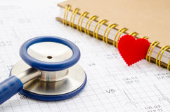 Medical stethoscope and red heart lying with diary. Stock Image