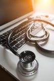 Medical Stethoscope Resting on Laptop Computer Keyboard. Stock Image