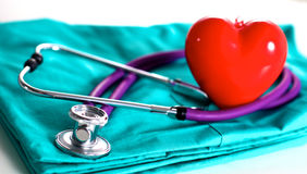 Medical stethoscope rests on a uniform close-up Royalty Free Stock Photo