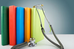 Medical stethoscope and stack of books. Medical professional edu. Cation and information concept Stock Photos