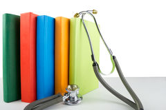 Medical stethoscope and stack of books. Medical professional edu. Cation and information concept Stock Image