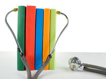 Medical stethoscope and stack of books. Medical professional edu. Cation and information concept Royalty Free Stock Photography