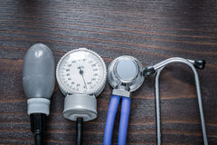 Medical stethoscope and tonometer on vintage Royalty Free Stock Photo