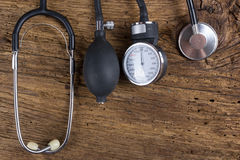 Medical Stethoscope on wooden desk background. Workplace of a doctor. Top view.  Stock Photo