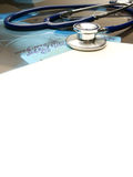 A medical stethoscope, x-ray images and a paper Royalty Free Stock Photo