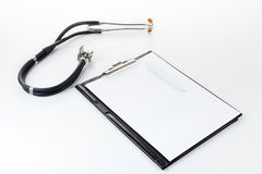 Medical stetoscope on the light surface Royalty Free Stock Images
