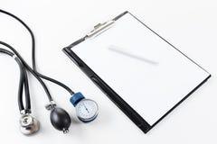 Medical stetoscope and tonometer Stock Photo