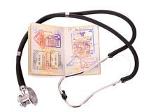 Medical still life with stethoscope and passport.