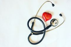 Medical Still Life. Stethoscope and red heart on a white background Royalty Free Stock Photo