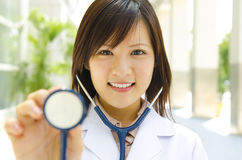 Medical student. Asian medical student with stethoscope in hand Stock Image