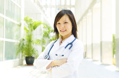 Medical student. A young medical student standing in front modern building Royalty Free Stock Photography
