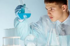 Medical student. Or scientific researcher studying substances in the laboratory Royalty Free Stock Images