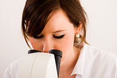 Medical student. Close up of a medical student looking through microscope in laboratory Stock Photos
