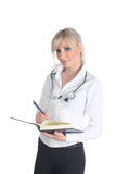 Medical student. Blond medical student/intern wearing a stethoscope around her neck and holding a notebook, isolated on white Royalty Free Stock Photos