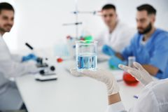 Medical student with beaker working in laboratory royalty free stock photography