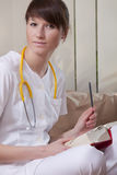 Medical student with book. Portrait of female medical student with a book Stock Photos