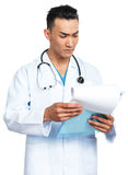 Medical student with a clipboard. A young serious male medical student (nurse, doctor, intern) with a clipboard Royalty Free Stock Photography