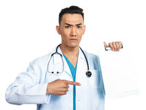 Medical student with a clipboard. A young serious male medical student (nurse, doctor, intern) with a blank clipboard Stock Photo