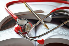 Medical student equipment. Are : books and stethoscope and pen Royalty Free Stock Photos