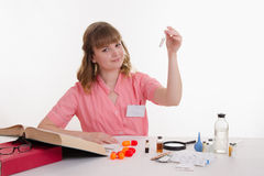 Medical student examines powder in a test tube Royalty Free Stock Images
