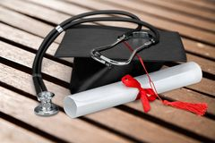 Medical Student Graduation. Education Diploma Stethoscope Mortar Board Student Certificate Royalty Free Stock Photos